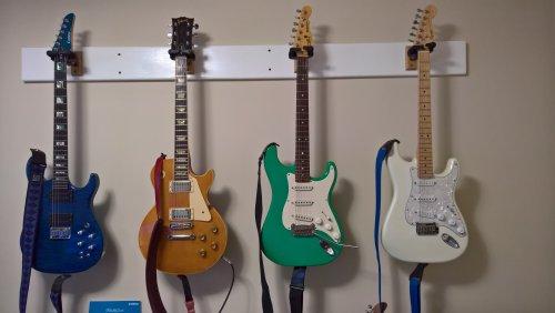 1537757763_GuitarWall.jpg.b15a4494fa4a211c9dec1199ab202d9e.jpg